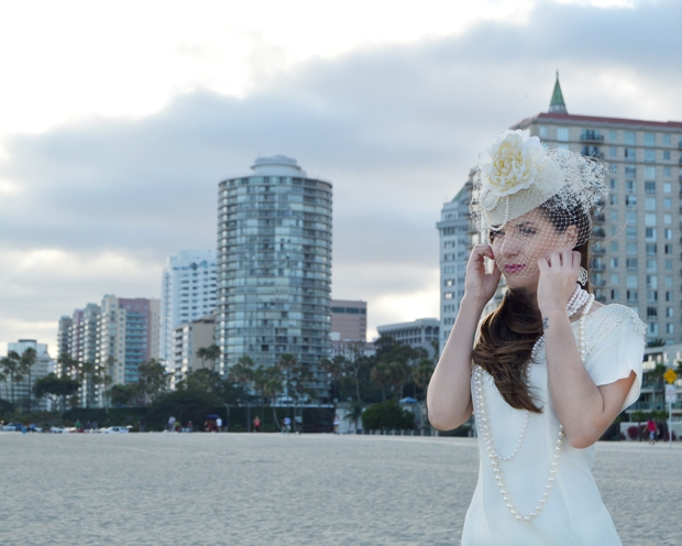 The Galen Bridal Hat by White Purls with the International Tower