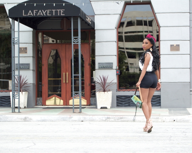 Daeon photographed at the La Fayette in Long Beach while wearing the Angelina Hat in Fuchsia by White Purls