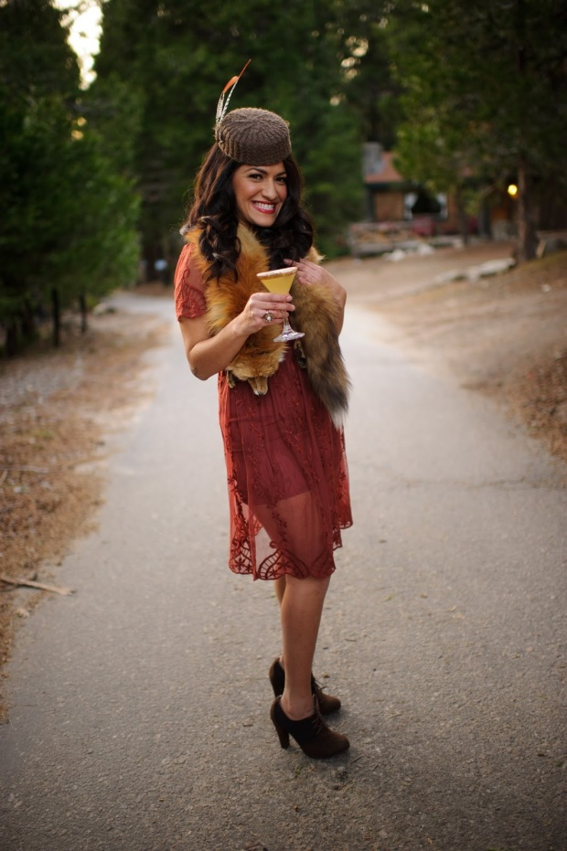 Pamela Trujillo Posing for Sol Bartending while wearing the Pamela Pillbox Hat by White Purls